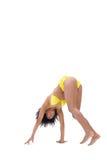 Fit girl in yellow bikini bending Royalty Free Stock Photography