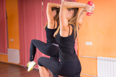 Fit Girls Holding Dumbbells Behind Their Heads Stock Photos