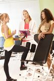 Fit girls and personal trainer at the gym Stock Photography