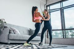 Fit girls preparing legs workout. Leg stretching exercise fitness woman doing warm-up, hamstring muscles stretch. Fit girls preparing legs workout. Leg stock image