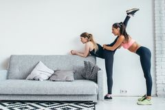 Fit girls preparing legs workout. Leg stretching exercise fitness woman doing warm-up, hamstring muscles stretch. Fit girls preparing legs workout. Leg stock photos