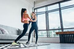 Fit girls preparing legs workout. Leg stretching exercise fitness woman doing warm-up, hamstring muscles stretch. Fit girls preparing legs workout. Leg stock photography