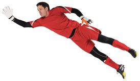 Fit goal keeper jumping up. On white background stock images