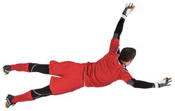 Fit goal keeper jumping up. On white background royalty free stock photos