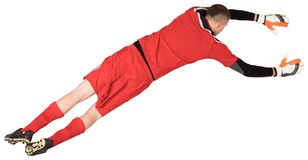 Fit goal keeper jumping up. On white background royalty free stock image
