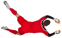 Fit goal keeper jumping up. On white background stock image