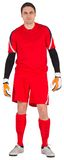 Fit goal keeper looking at camera. On white background stock photos