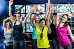 Fit group dancing and smiling Royalty Free Stock Photo