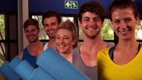 Fit group holding their fitness mat. In crossfit stock video footage