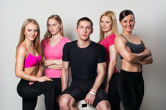 Fit group posing and smiling in studio Royalty Free Stock Photos