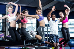 Fit group smiling and jumping Royalty Free Stock Images
