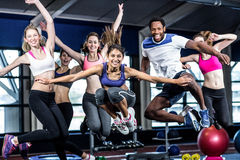 Fit group smiling and jumping Stock Photography