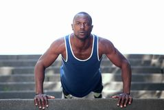 Fit handsome african american man exercise push ups Stock Image