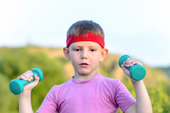Fit Handsome Boy Lifting Two Small Weights Royalty Free Stock Images