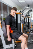 Fit handsome man working out in gym Stock Photography