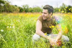 Fit handsome young man relaxing lying on lawn Royalty Free Stock Photo