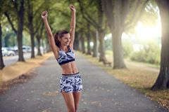 Fit happy slender healthy young woman in sportswear royalty free stock images