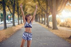 Fit happy slender healthy young woman in sportswear stock photography