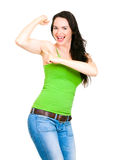 A fit happy woman pointing to flexed muscle. A very fit healthy and beautiful woman smiling and pointing at big strong arm muscle Royalty Free Stock Image
