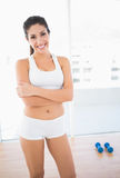 Fit happy woman in sportswear smiling at camera Stock Photo