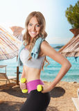 Fit happy woman working out on the beach Royalty Free Stock Photo