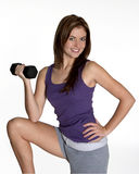 Fit and healhy. Young woman  with dumbbell Stock Photos