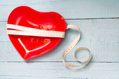 Fit and health abstract concept with red heart plate Stock Images