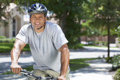 Fit & Healthy African American Man Riding Bike Royalty Free Stock Image