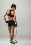 Fit healthy athletic woman with a skipping rope Royalty Free Stock Image