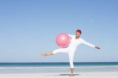 Fit healthy exercising senior woman at beach Stock Image
