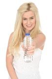 Fit Healthy Happy Attractive Young Blonde Woman Holding a Bottle of Mineral Water Stock Image