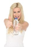 Fit Healthy Happy Young Blonde Woman Holding a Bottle of Mineral Water Stock Photos