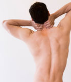 Fit healthy man holds his neck in pain stock image