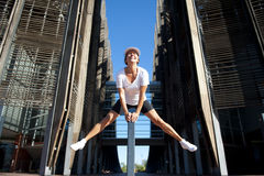Fit and healthy mature woman jumping II. An attractive looking mature woman in her fifties is keeping fit and healthy by jumping up high in the air with Royalty Free Stock Photos