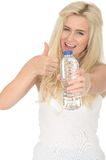 Fit Healthy Positive Young Blonde Woman Holding a Bottle of Mineral Water Royalty Free Stock Image