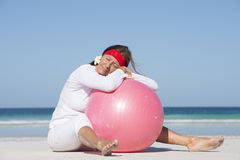 Fit healthy senior woman relaxed at beach Stock Images