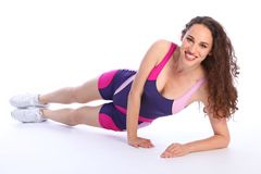 Fit healthy smiling woman doing exercise stretch Stock Photography