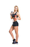 Fit, healthy and sporty woman in sportswear isolated on white Stock Photography