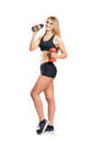 Fit, healthy and sporty woman in sportswear isolated on white Stock Photo