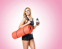 Fit, healthy and sporty woman in sportswear  isolated on white. Stock Photos