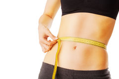 Fit and healthy waist measured with a tape Royalty Free Stock Image