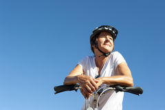 Fit and healthy woman on a bike ride Royalty Free Stock Photography
