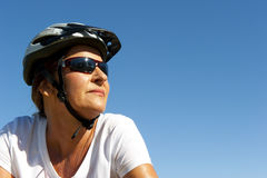 Fit and healthy woman on a bike ride Stock Image