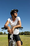 Fit and healthy woman on a bike ride Royalty Free Stock Images