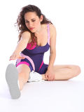 Fit and healthy woman does hamstring stretch Stock Image