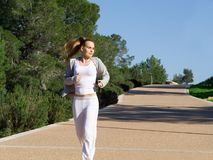 Fit healthy woman jogging Stock Image