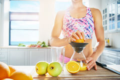 Fit healthy woman making fresh juice Royalty Free Stock Image