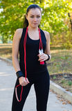Fit healthy woman with skipping rope Stock Image