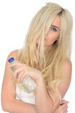 Fit Healthy Young Natural Blonde Woman Holding a Bottle of Mineral Water Royalty Free Stock Photography