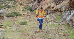Fit healthy young woman hiking on a trail Stock Photography